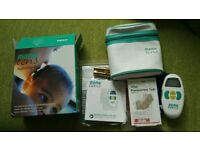 Mama Tens Machine with replacement pads.