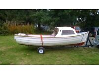 Fishing boat 17ft with cuddy and outboard