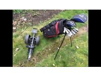 Set of left handed golf clubs and trolley