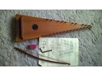 bowed psaltery with tuning key and rosin