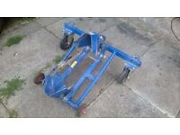 Motorcycle towing dolly for transporters