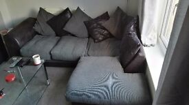 Corner sofa and 3 seater. Scatter back, black and grey. 3 years old. Can be delivered