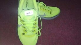 Neon green woman nike trainers