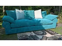 A New 4 Seater Teal Cord Fabric Scatter Back Sofa.