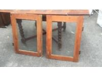 Matching pair of wood doors with glass insert