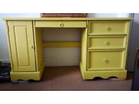 Yellow desk with drawers and pull out keyboard tray