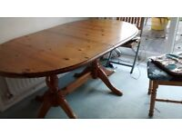 Extending dining solid pine wood table.