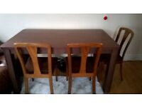 Large Dining table and 3 chairs solid wood