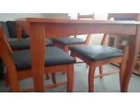 Solid wood dining table and 4 chairs. Excellent Condition.