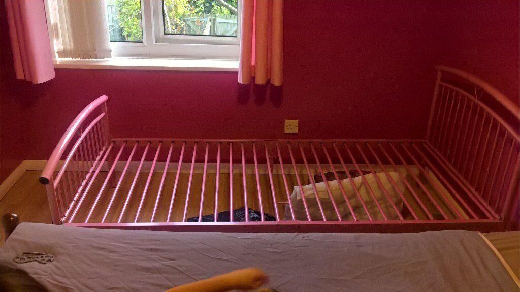 pink metal single bed