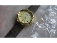 brown new watch. comes in a packet