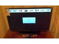 """brand new Toshiba 32"""" tv with stand and remote model 32w1333b"""