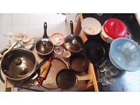Kitchen cooking utensils including pots and pans