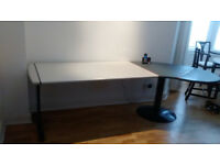 Large elegant designer desk by Knoll, with curved table end. Neutral colours. Dismantles.