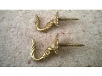 Antique brass ornate hooks / curtain tiebacks in good condition set of two Collect only