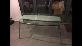 Glass & chrome table seats 6 easily