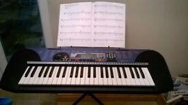 Yamaha PSR140 electronic keyboard with adjustable stand