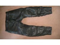 RST leather motorcycle trousers.