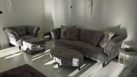 "DFS ""Concerto"" suite comprising 4 seater and 3 seater sofas plus 1 armchair and 2 footstools."