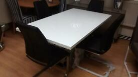 chrome and white high gloss designer table and 4 black and chrome cantilever chairs