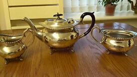 An Antique Silver Tea Pot Set.