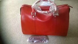 Luxury Red Leather Barrel Bag from M & S..Brand new