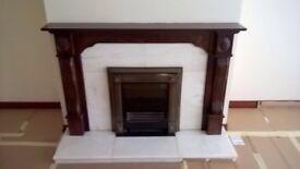 Mahogany surrounded marble fireplace