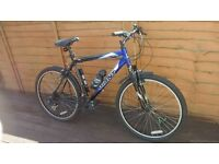"mountain bikes giant and a mongoose both adult 26"" wheel"