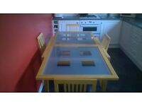 Julian Bowen dining table and 4 chairs