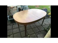 WOODEN OVAL EXTENDABLE DINING TABLE
