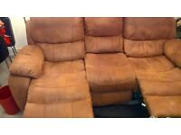 3 seater sofa with two reclining chairs.