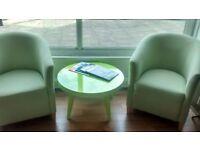 Neon green coffee table (designer Sia) plus two green fabric tub chairs