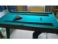 Folding pool table