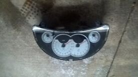 Vauxhall corsa c white dial clocks