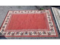 RED/SALMON /BEIGE PATTERNED OUTER EDGE RUG MEASURES APPROX 120 CM X 169 CM.