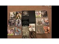 PS3 slim, with 15 games and 2 controllers and all wires.