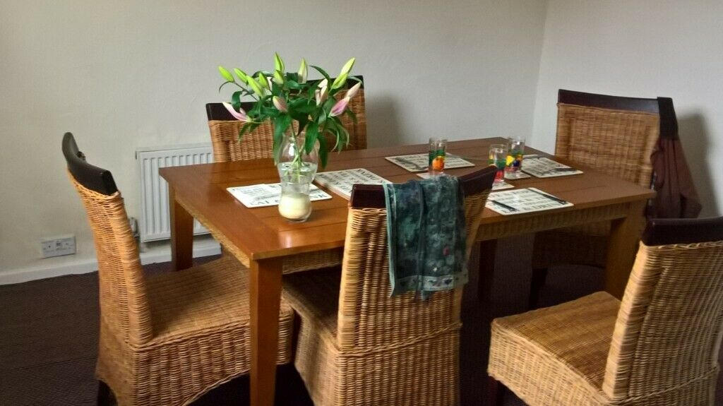 Solid wood dining table and 6 wicker chairs | in Bredbury ...