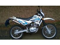 Sinnis Blade 125 Motorcycle, white, fitted with Toro exhaust in excellent condition.