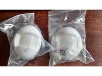 YALE- White wireless PIR unit (movement sensors) x 2. Unused and in packaging.