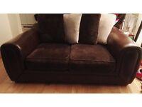 2 seater sofa half leather.half brown fabric