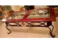 practical and attractive coffee table/antique type metal base /dark wood effect top / tempered glass