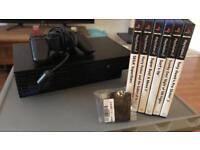 PS2 + DualShock Pad + 6 Games + 128MB memory card