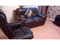 Can deliver real leather 2 seater and recliner spinner chair both in very good cond
