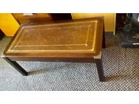 Coffee table with leather insert