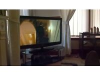 55 inch Baird 1080p television and stand