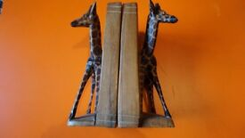 PAIR OF VINTAGE HEAVY BOOK ENDS SOLID HARD WOOD HAND CARVED GIRAFFES.