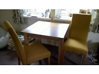 New Oak extending table and 2 upholstered chairs for sale