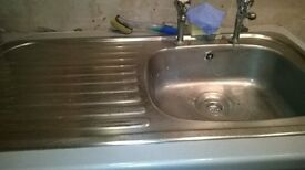 stainless steel kitchen sink including taps