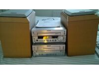 Sony silver stereo radio, cd player, tape cassette, with speakers. Instructions inc.