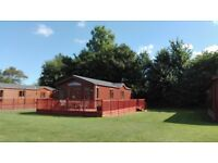 Private pitch Holiday Lodge for sale at Yaxham Waters Holiday Park in the rural county of Norfolk